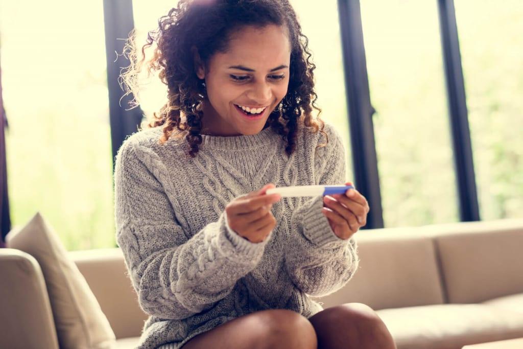women-pregnancy-test-happy